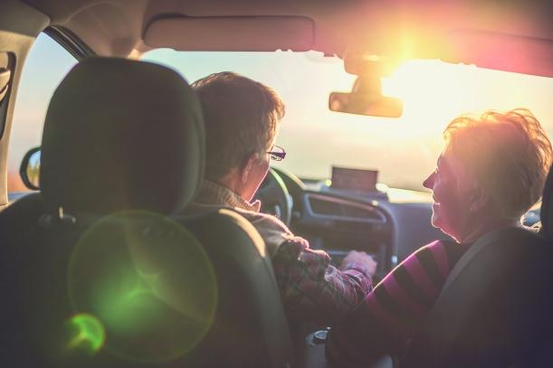 Senior couple enjoying a drive