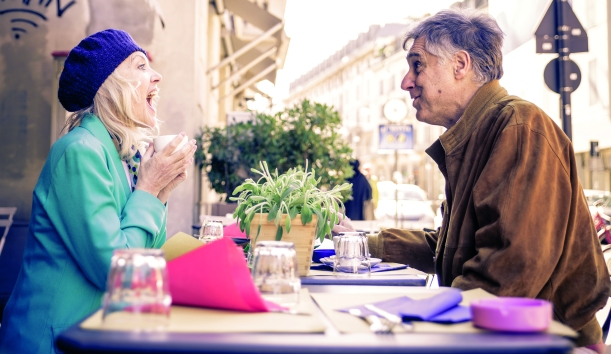 Senior couple having a coffee in a bar